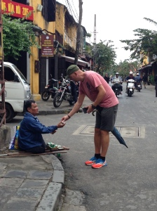 Me buying a Tiger Balm from a blind one legged man. He didn't beg, he sold tiger balm. He dealt with what life have given him, and he earned my respect for that.