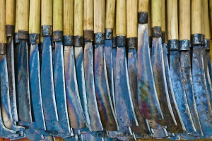 Lao P.D.R., Laos, Luang Prabang, street display of knives with  wooden handles Taken from : glenallison.photoshelter.com
