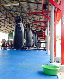 Bags ready to be punched. And the little green water bucket used to disinfect your feet before stepping onto the mats.