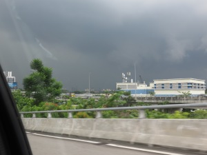 Weather rolling into Kuala Lumpur seen from the back seat of a taxi